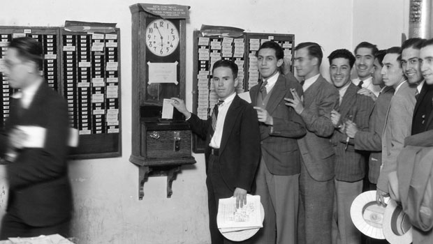 Employees of Mexico's Power and Light Co. clock in on ITR time clocks.