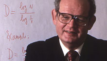Benoit Mandelbrot at an IBM computer
