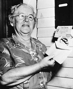 Ida May holding the first social security check