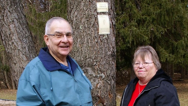 Ray Schwegel and his wife Marge identify and tag trees—tracking their locations by means of a handheld GPS.