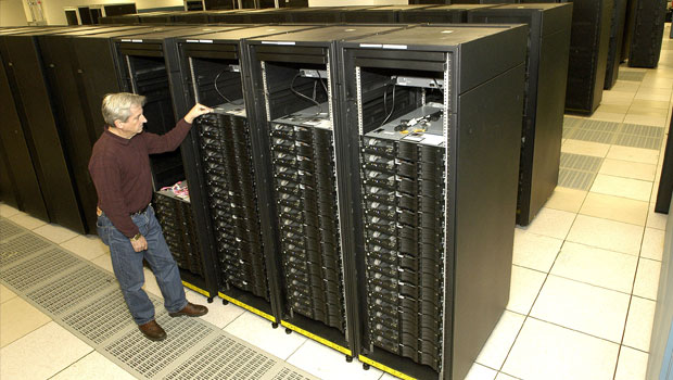 Man standing next to the Roadrunner computer