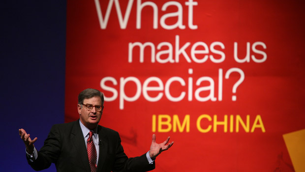 "Sam Palmisano before a sign ""What makes us special? IBM China"""