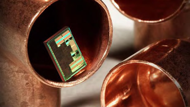 A tiny copper chip compared to the size of copper piping
