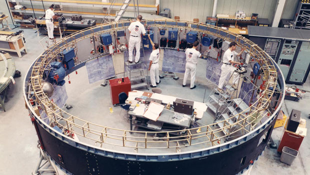4 men working inside the Saturn V instrument unit