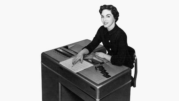 Woman at an automated test scoring machine