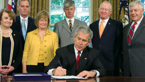 President George W. Bush signing the US Genetic Information Nondiscrimination Act