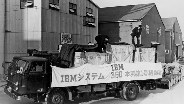 Two men standing on truck w/System/360 logo