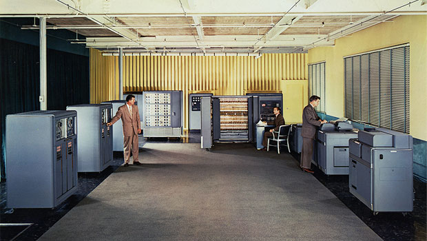 Three people working at the IBM 701