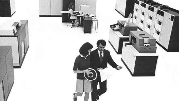 Man and woman walking through a room with a System/370