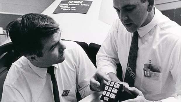 Men discussing numeric keyboard to the guidance computer