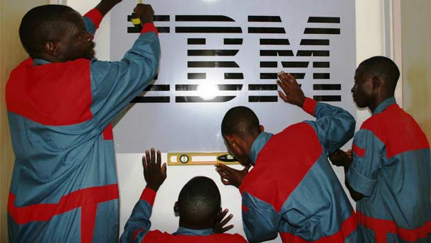 Men hanging the IBM logo in Tanzania office