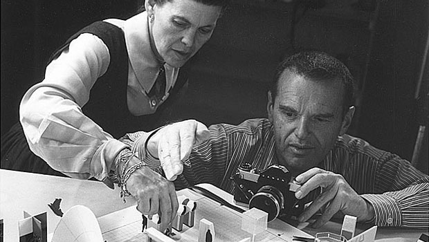 Charles and Ray Eames photographing a design model