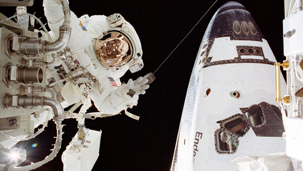 Astronaut on a space walk outside the shuttle Endeavor.