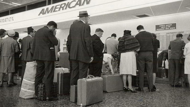 Travelers at American Airlines counter (1966)