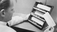 Man putting a punched card into sorting slots
