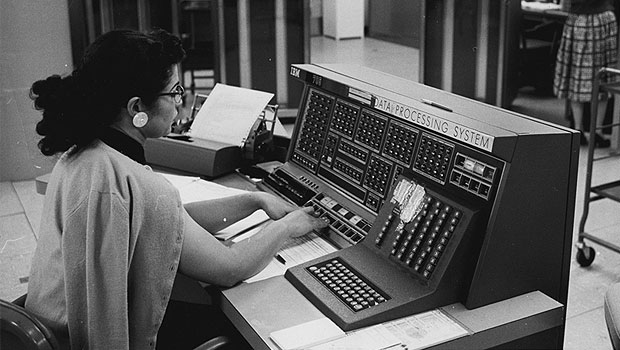 Woman working at an IBM 705 console