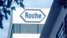 The Roche logo on the side of a building