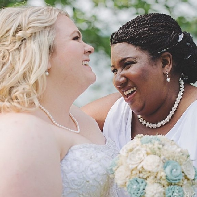 Leah Brome and her wife in wedding their dresses