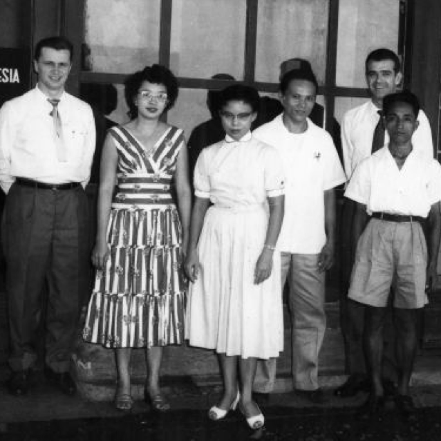 Black and white image of people, that shows IBM's history in Southeast Asia