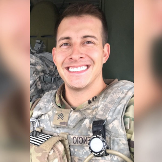 Soldier smiling in camouflage