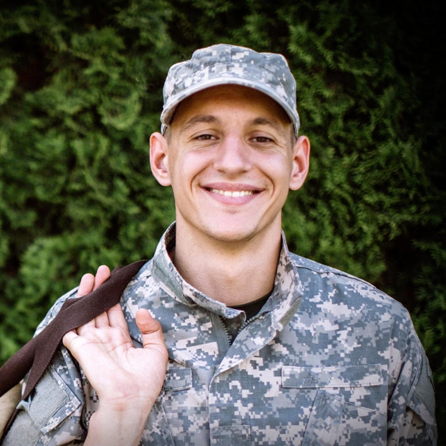 Soldier smiling while wearing camouflage
